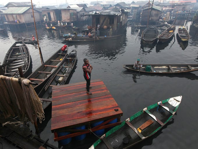 A man stands on the dock where a proposed floating school would be built for residents in the floating slum of Makoko in Lagos, Nigeria.