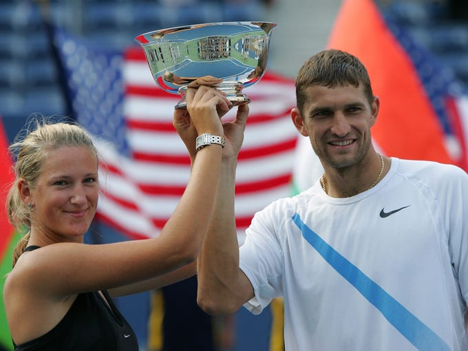 Victoria Azarenka, left, and Max Mirnyi pose together with their 2007 U.S. Open mixed doubles champion's trophy. The Belarusians would go on to the win the 2012 London Olympics mixed doubles title together five years later.