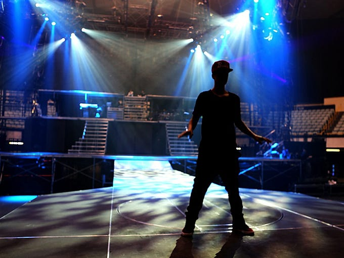 """Justin Bieber is caught in the spotlight during rehearsals at Long Beach Arena for his upcoming <i>Believe</i> world tour, which kicks off Saturday night in Glendale, Ariz. Bieber has been putting in up to 10 hours a day practicing elements of the sprawling production. Says his manager, Scooter Braun: """"For the last tour we rehearsed for two weeks, this time we had two months."""""""