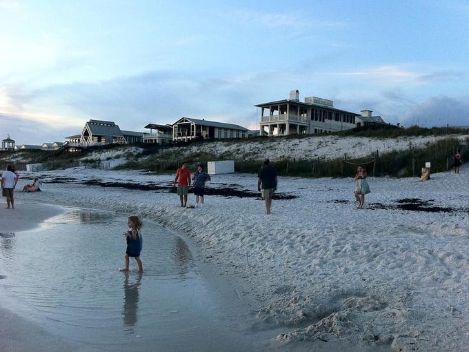 Seaside, Florida, is a planned beach community where there are no high-rise condos or fast-food outlets, and a sense of community is encouraged.  Families, lovers and others gather on the beach to watch spectacular sunsets.