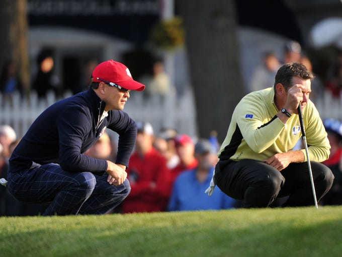 Zach Johnson and Lee Westwood line up putts. Johnson and Jason Dufner defeated Westwood and Francisco Molinari.