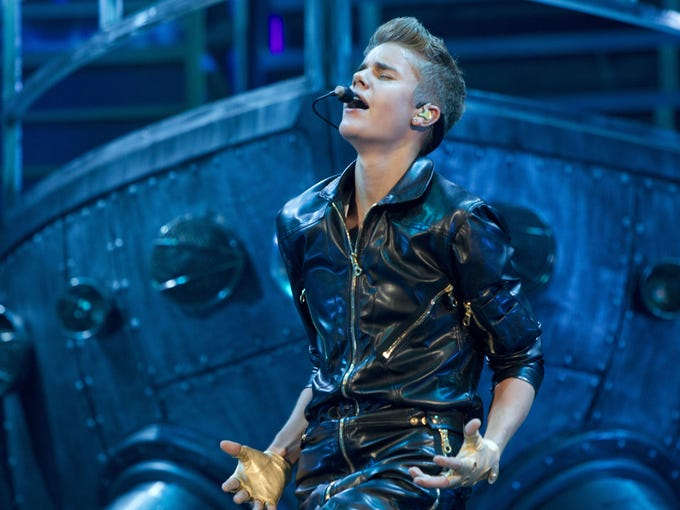 Justin Bieber's Believe tour got off to a rough start -- the singer puked twice during his first show. However, the superstar powered through his multimedia presentation, which premiered Saturday in Arizona.