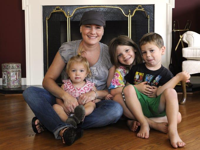 Christina Miller with her children, Nora, 17 months, Alex, 5, and T.J., 4.  Miller is battling breast cancer.