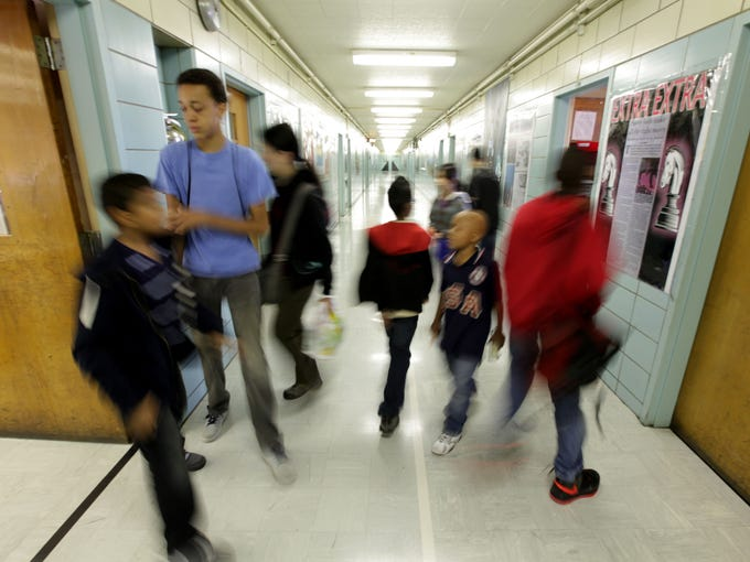 Students from I.S. 318 in New York's borough of Brooklyn move from room to room during a Saturday morning chess class.