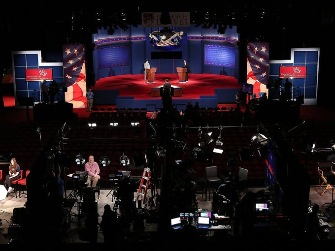 Workers stage a dress rehearsal for Wednesday's presidential debate at the University of Denver. This will be the first of three presidential debate between President Obama and challenger Mitt Romney.