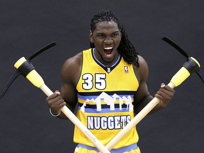 Denver Nuggets forward Kenneth Faried poses for a portrait during media day at the Pepsi Center.