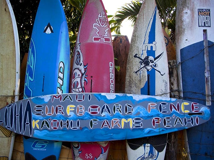 """In the town of Haiku on the island of Maui, the """"Surfboard Fence"""" draws curious visitors and neighbors."""
