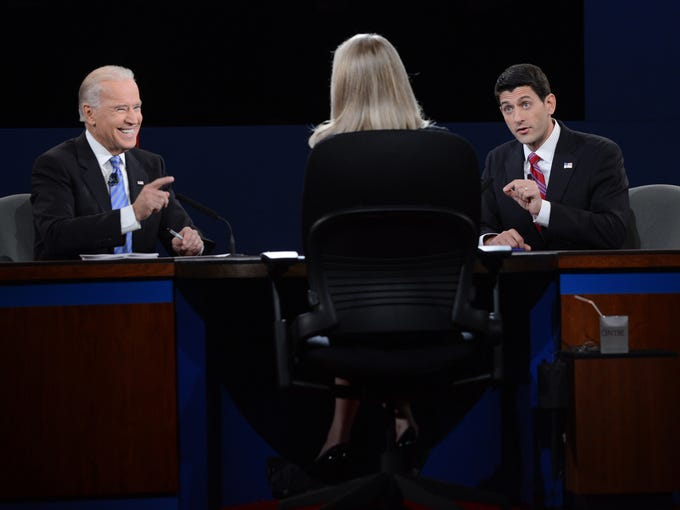 Vice President Biden, left, and Rep. Paul Ryan respond to questions posed by moderator Martha Raddatz of ABC News.