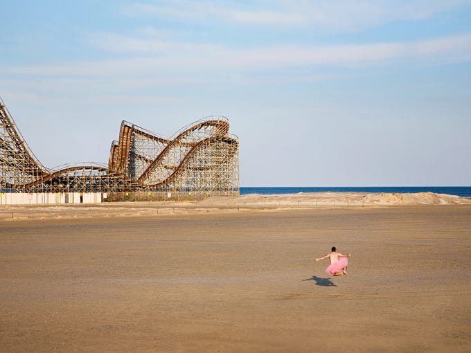 """Professional photographer Bob Carey decided to support his wife and others in their struggle against breast cancer by creating self-portraits wearing his pink tutu. He published his images in a book titled """"Ballerina"""" and can be found at thetutuproject.com. This image is called """"Roller Coaster,"""" dated 2008."""