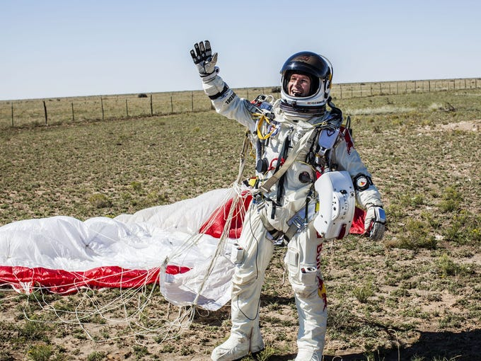 Felix Baumgartner of Austria celebrates after successfully jumping from a capsule that was lifted 24 miles in space.