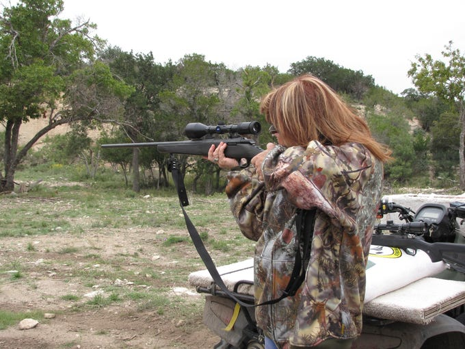 Kathy Simmons, owner of the Dry Hollow Ranch near Kerrville, Texas, takes aim on the shooting range. The ranch''s Botox & Bullets Getaways blend firearm instruction with spa treatments.