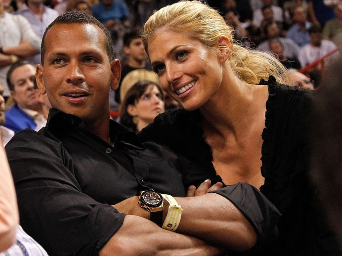 Torrie Wilson: Rodriguez, seen here mingling at an NBA game, has been dating the former wrestling diva in a very public relationship that started in 2011 and has lasted until nowish.