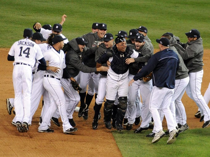 Game 4: The Tigers celebrate on the  field at Comerica Park in Detroit after routing the New York Yankees 8-1 to sweep the ALCS 4-0.