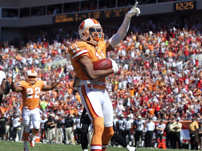 The Tampa Bay Buccaneers busted out the the creamsicle throwback uniforms for their Week 7 game against the New Orleans Saints. Wide receiver Tiquan Underwood is shown here celebrating after scoring a touchdown in the first quarter at Raymond James Stadium.