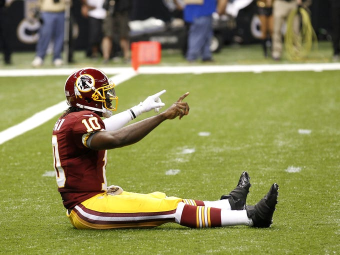 """Robert Griffin III brings """"Griffining"""" into the public lexicon with this pose following a touchdown throw in his Week 1 debut against New Orleans."""