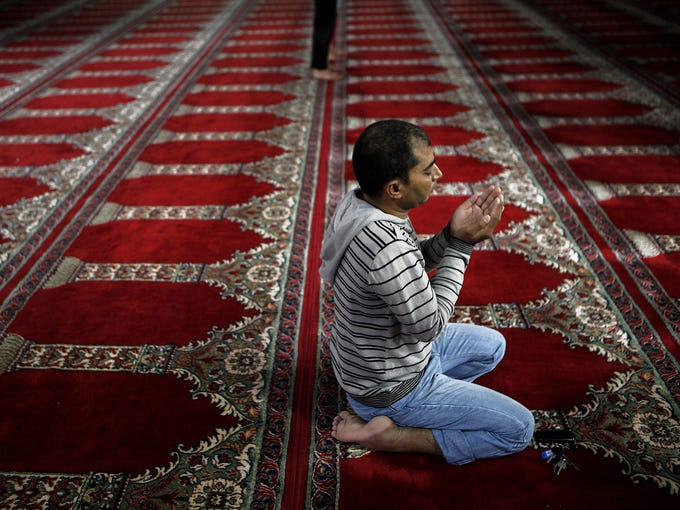A Muslim man prays in the Omeriye Mosque during the Eid al-Adha celebration on Oct. 26 in Nicosia, Cyprus.The religious festival is celebrated by millions of Muslims worldwide and commemorates the willingness of prophet Ibrahim to sacrifice his son as an act of obedience to God.