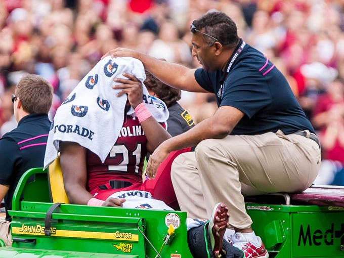 South Carolina Gamecocks running back Marcus Lattimore is carted off the field after injuring his leg against the Tennessee Volunteers on October 27, 2012.