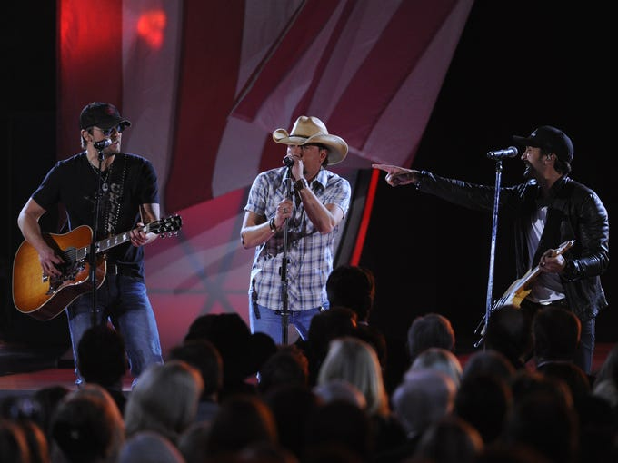 Erich Church, left, Jason Aldean and Luke Bryan open the annual CMA Awards on Nov. 1, performing The Only Way I Know.
