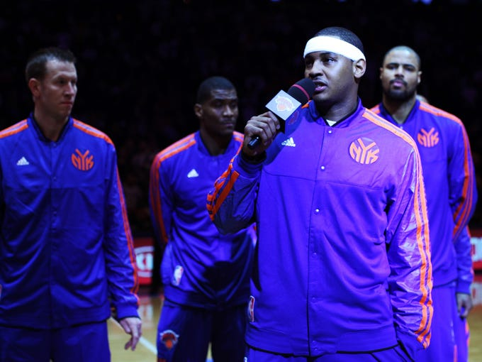 Carmelo Anthony of the New York Knicks addresses the crowd in regards to hurricane Sandy prior to the home opener against the Miami Heat at Madison Square Garden. See the other images from Friday's emotional game.