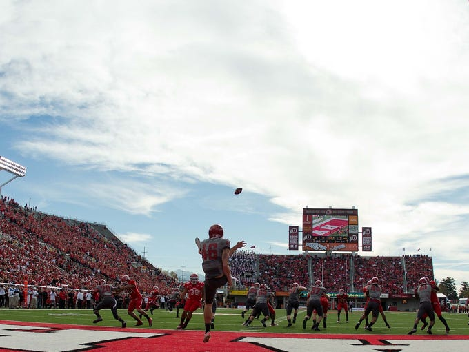 Washington State Cougars kicker Michael Bowlin punts from his own end zone during the first quarter against the Utah Utes at Rice-Eccles Stadium.