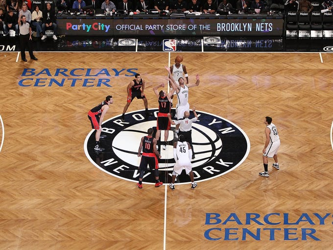 Professional sports officially returned to Brooklyn on Saturday night, when the Nets opened the Barclays Center with a 107-100 win over the Toronto Raptors.