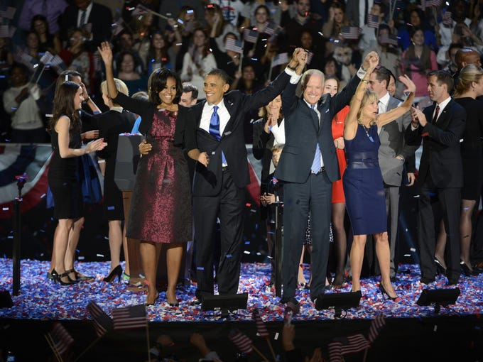 President Obama, first lady Michelle Obama, Vice President Biden and Jill Biden wave at his election-night rally Wednesday, Nov. 7, 2012, in Chicago. Obama defeated Republican challenger former Massachusetts Gov. Mitt Romney.