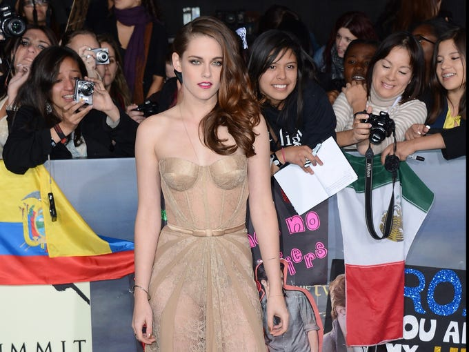 """Emotions were running high at the premiere of 'The Twilight Saga, Breaking Dawn, Part 2' on Nov. 12, which marked the 'Twilight' cast's last U.S. premiere. """"I'm just trying to absorb it,"""" Kristen Stewart told reporters, as thousands of fans screamed and offered up posters, flags and books for the cast to sign. One female fan even arrived with the word 'Twihard' shaved into the side of her head. (Stewart gave her an autograph.) """"I'm trying to be here,"""" said the actress, dressed in a nude Zuhair Murad gown. What will she miss most? """"You don't ever get to share movies on such a vast - I mean, I have something in common with every single one of these people here, which doesn't happen,"""" she said. """"It's really cool."""""""