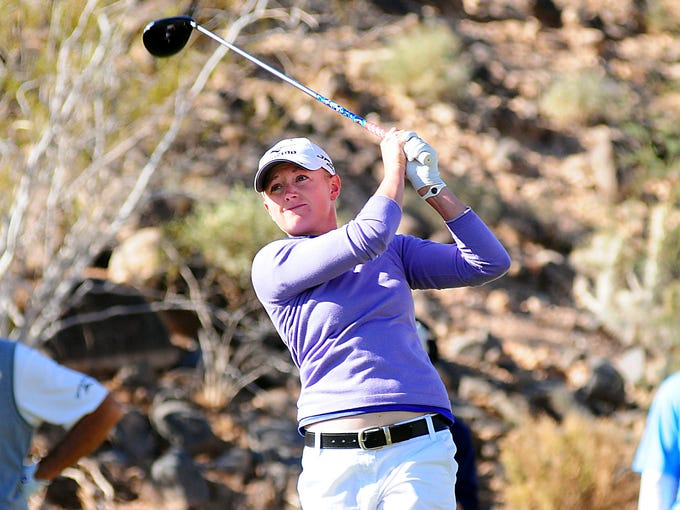 Stacy Lewis, shown here competing in the Wendy's 3 Tour Challenge, is the first American since 1994 to earn LPGA player of the year honrs.
