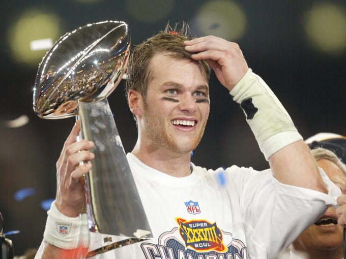 Brady celebrates after the Patriots' 32-29 win over the Carolina Panthers in Super Bowl XXXVIII in Houston, Brady's second title.