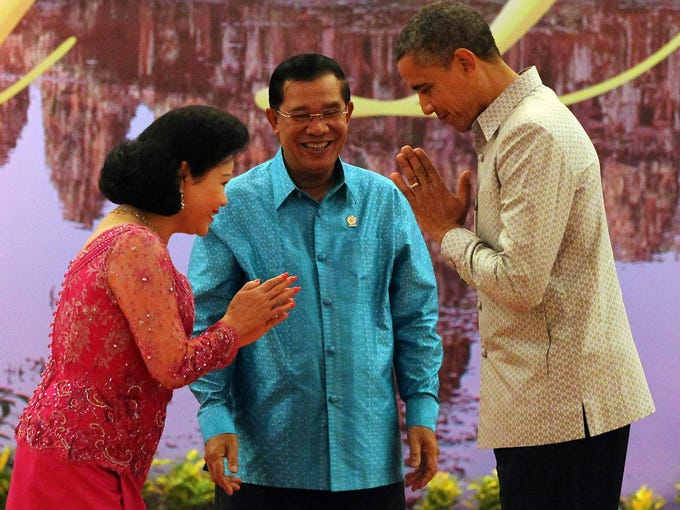 President Obama returns a greeting to Bun Rany, wife of Cambodian Prime Minister Hun Sen, before the start of a gala dinner on Nov. 19 in Phnom Penh, Cambodia.