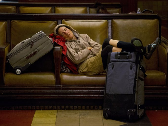 A traveler sleeps at Union Station on Nov. 21 in Los Angeles.