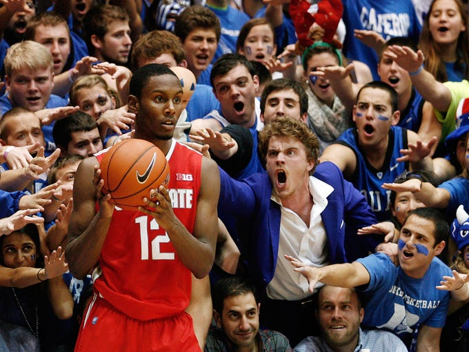 Duke 73, Ohio State 68: Blue Devils fans taunt Ohio State Buckeyes forward Sam Thompson (12) as he takes out the ball during the second half at Cameron Indoor Stadium.