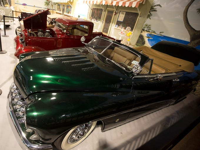 A 1950 Mercury Custom Convertible and other vehicles belonging to John Staluppi are on display at a private museum on Nov. 27 in North Palm Beach, Fla. Staluppi's 120-vehicle Cars of Dreams Collection will be for sale at an auction on Dec. 1 in West Palm Beach.
