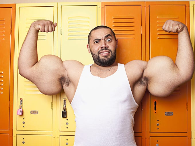 In this handout photo provided by Guinness World Records, Moustafa 'Mo' Ismail poses for a photograph with the worlds largest biceps on September 12 2012 in London, England. Measuring 64.77 cm (25.5 in) He will claim the title of 'Largest Guns' in the 2013 edition of The Guinness World Records Book.