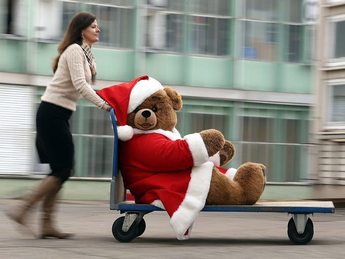 A giant stuffed teddy bear is wheeled through the Steiff toy factory on Nov. 23 in Giengen an der Brenz, Germany. Founded by Margarethe Steiff in 1880, the company has been making stuffed teddy bears since the early 20th century.