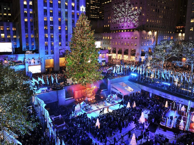 People attend the 80th annual Rockefeller Center Christmas tree lighting ceremony on Nov. 28 in New York City.