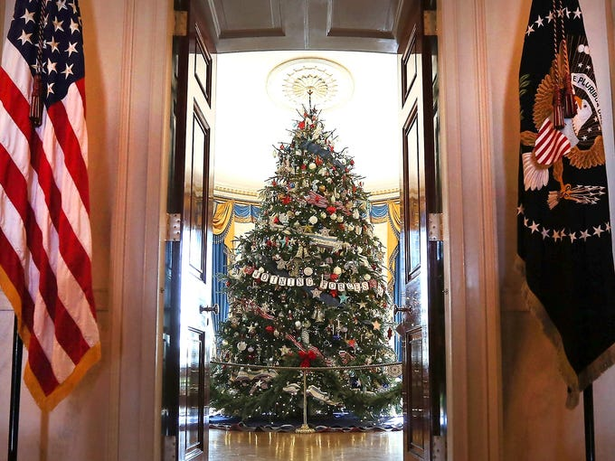 The official White House Christmas tree stands in the Blue Room of the White House on Nov. 28. The tree, a Fraser Fir from Jefferson, N.C., is 18 feet, 6 inches tall.