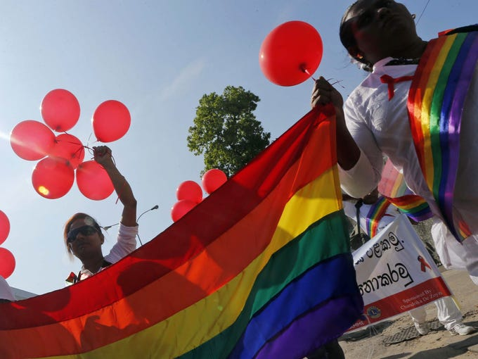 Members and supporters of the lesbian, gay, bisexual and transgender community participate in an event organized to mark World AIDS Day on Saturday in Colombo, Sri Lanka.