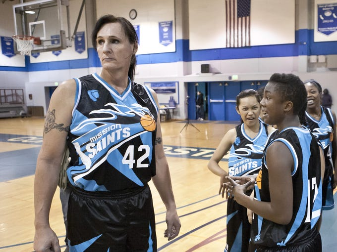 """Gabrielle Ludwig, 50, a transexual basketball player at Mission College in Santa Clara, CA stands with her team during a game at the Contra Costa """"Comets"""" Tournament on the Contra Costa College campus."""