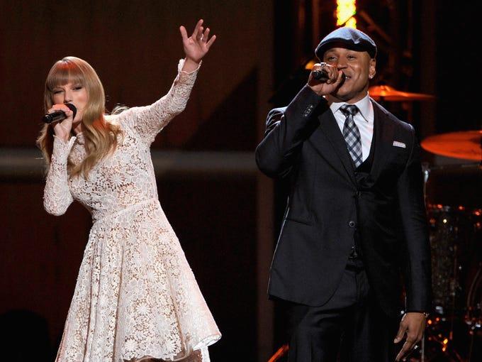 Singer Taylor Swift (L) and rapper LL Cool J host The GRAMMY Nominations Concert Live!! held at Bridgestone Arena on December 5, 2012 in Nashville, Tennessee.