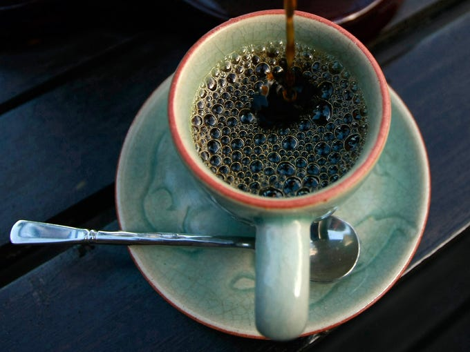 A cup of Black Ivory coffee is poured at a hotel restaurant in Chiang Rai province, Thailand. The $500 per pound blend of coffee is produced from beans picked from the excrement of elephants.
