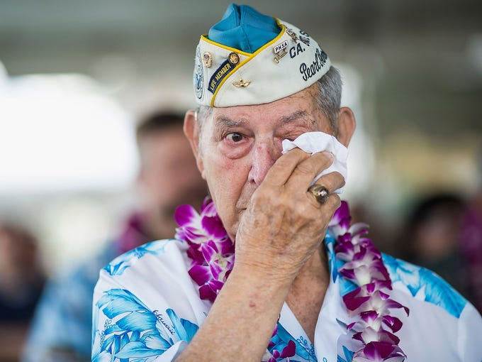 Pearl Harbor survivor Victor Miranda wipes his eyes during the 71st annual ceremony commemorating the Japanese attack on Pearl Harbor on Dec. 7. It took place at the World War II Valor in the Pacific National Monument at Pearl Harbor, Hawaii.