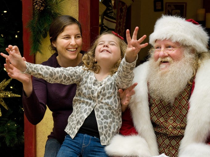 Sophia Nerhood, center, and her mother, Jackie, smile as she sits on Santa's lap during The Caring Santa event on Dec. 2 in Westminster, Calif. The event provided a calm environment for special needs children before the mall opened to the public.