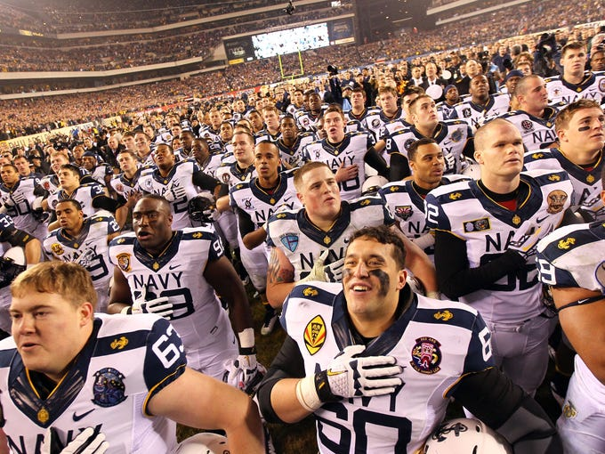 The Navy Midshipmen react during their Naval Academy alma mater after Navy beat the Army Black Knights 17-13 at Lincoln Financial Field in Philadelphia.