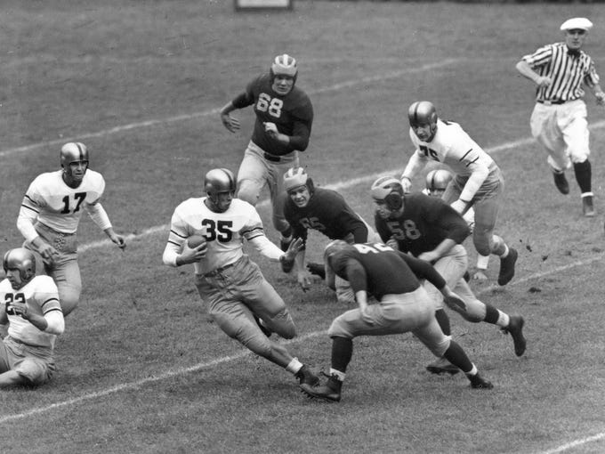 "Army running back Doc Blanchard, ""Mr. Inside,"" became the first non-senior to win the Heisman in 1945."