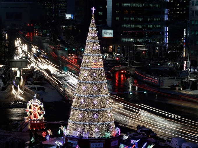 A Christmas tree towers above traffic in front of City Hall on Dec. 5 in Seoul, South Korea.