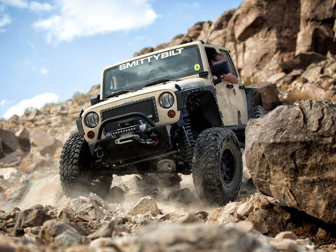 Greg Adler, CEO of 4WheelParts, says a winch, such as this SmittyBilt waterproof model on the front bumper, will satisfy any truck or Jeep owner. Black wheels, such as these Pro Comp La Paz products, are also an option.