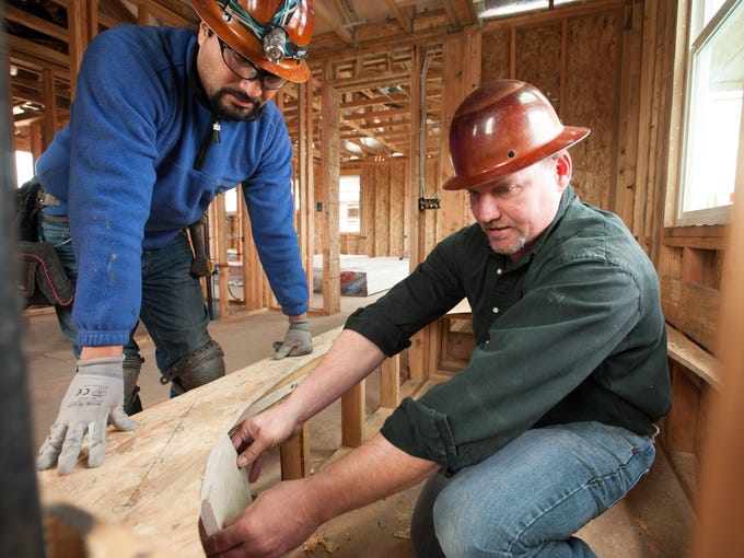 Nationwide, single-family home starts will be up 25% this year from 2011. In Sunnyvale, Calif., plumbing foreman Josue Avila and senior construction manager John Almash discuss measurements for a new layout for faucets for a tub.