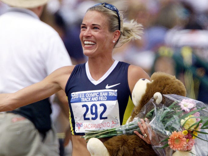 Suzy Favor Hamilton is all smiles while running a victory lap after the women's 1,500 meters at the U.S. Olympic Track and Field Trails in 2000.
