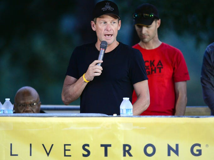 Lance Armstrong speaks at the annual Team Livestrong Challenge on Oct. 21. On Monday he apologized to staff members.